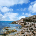 Beautiful rocky sea coast under blue sky Royalty Free Stock Photos