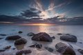 Beautiful rocky sea shore at sunrise or sunset. Royalty Free Stock Photo
