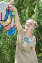 Beautiful romantic blonde girl in retro style plays with statue playing of horse summer garden on sunny afternoon Royalty Free Stock Images