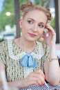 Beautiful romantic blonde girl in retro style portrait of a dress on the street Stock Images