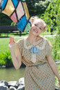 Beautiful romantic blonde girl in retro style standing near stat statue of horse summer garden on sunny afternoon Royalty Free Stock Image