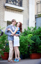 Beautiful romantic couple hugging near their house Royalty Free Stock Photo