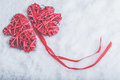 Beautiful romantic vintage red hearts together on a white snow background Royalty Free Stock Photo