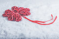 Beautiful romantic vintage red hearts together on a white snow background. Love and St. Valentines Day concept. Royalty Free Stock Photo