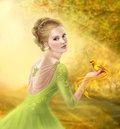 Beautiful romantic woman and fantasy gold bird