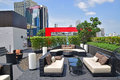 Beautiful rooftop settings for relaxation and recreational activities this is typical hotel in bangkok with fancy bar Stock Photo