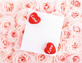 Beautiful roses with gift card & hearts Stock Image