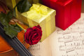 Beautiful roses, gifts and violin! Stock Photo