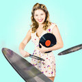Beautiful s dj pinup girl with record music disc retro portrait of a beauty hairstyle and makeup playing a mix of jukebox songs Stock Photos