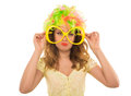 Beautiful sad girl in colored wig and a beautiful up make up wit with big glasses on white background Stock Photo