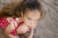Beautiful Sad little girl is looking with serious face at camera Royalty Free Stock Photo