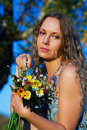 Beautiful sad woman with a flowers. Stock Images
