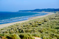 Beautiful sand beach in co wexford dune system ireland beaches blue flag and green coast with warm golden and blue sea Stock Images