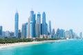 Beautiful Sandy Beach and Modern Metropolitan Skyline Royalty Free Stock Photo