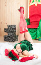 Beautiful Santa Claus assistant sleeping tired Royalty Free Stock Image
