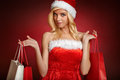 Beautiful santa claus girl gift bags choice with Royalty Free Stock Photo
