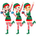 Beautiful santa elf helpers three claus holding christmas presents and waving hand Royalty Free Stock Images