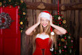 Beautiful Santa girl having fun and smiling near
