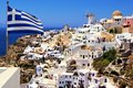 Beautiful santorini view of with greek flag Stock Images