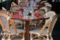 Beautiful scene of tables and cane chairs at outdoor patio of restaurant Royalty Free Stock Photo
