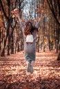 stock image of  Beautiful schoolgirl walks in the autumn park