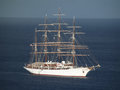 Beautiful sea cloud with sails furled motoring into the shelter of admiralty bay bequia Stock Photos