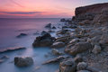 Beautiful sea coast at sunset Stock Images