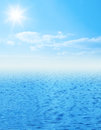 Beautiful sea horizon with clouds above it blue sun and on sky Stock Photography