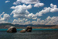 Beautiful sea lagoon with turquoise blue water and white clouds