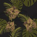 Beautiful seamless floral pattern background with tropical plants. Royalty Free Stock Photo