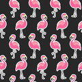Beautiful seamless pattern with flamingo stickers on black background Royalty Free Stock Photo