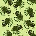 Beautiful seamless pattern with stylized green peacocks. Royalty Free Stock Photo