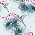Beautiful seamless vector floral summer pattern background with hummingbird, tropical pink lilies flowers and palm leaves.