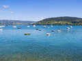 Beautiful seascape with boats in galicia spain a sunny day Stock Image