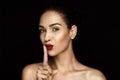 Beautiful seductive woman with shh symbol Royalty Free Stock Photo