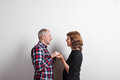 Beautiful senior couple in love holding hands. Studio shot. Royalty Free Stock Photo