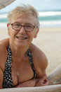 Beautiful senior woman closeup beach portrait of natural attractive happy on holidays at the beach Royalty Free Stock Images