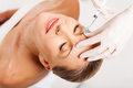 Beautiful senior woman receiving cosmetic injection her forehead Stock Images