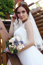 Beautiful sensual bride with dark hair in luxurious  wedding dress Royalty Free Stock Photo