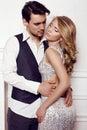 Beautiful sensual couple in elegant clothes posing in studio Royalty Free Stock Photo