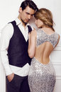 Beautiful sensual couple in elegant clothes posing in studio Royalty Free Stock Photo