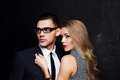 Beautiful sensual impassioned couple office love story fashion studio photo of Royalty Free Stock Photos