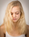 Beautiful Serious Blond Girl With Closed Eyes Royalty Free Stock Photo