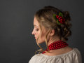 Beautiful serious young woman in Ukrainian embroidery