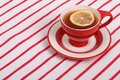 Beautiful serving tea ceremony lemon tea red cup striped tablecloth Royalty Free Stock Images