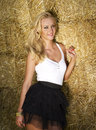 Beautiful sex young girl near a straw bales wall Royalty Free Stock Images