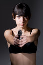 Beautiful sexual girl brunette with gun Royalty Free Stock Image