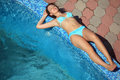 Beautiful sexual woman lying near pool on resort Stock Images