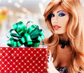 Beautiful sexy adult woman with a birthday gift red box portrait of green ribbon indoors Royalty Free Stock Photos