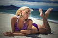 Beautiful blond woman on the beach. beauty girl in bikini. summer holidays Royalty Free Stock Photo